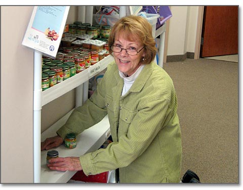 Volunteer stocking infant care items
